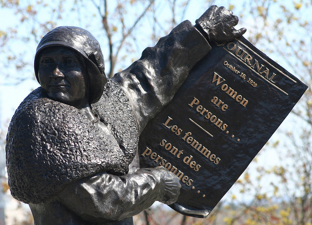 Statue of Nellie McClung holding Women Are Persons paper