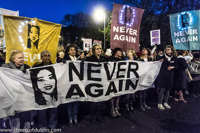 Colour photo of evening protest with banners of Savita Halappanavar and Never Again