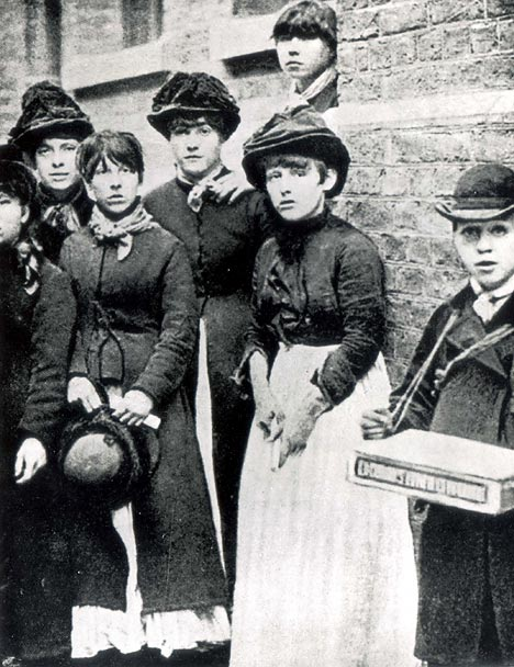 Black and white photo of several women who worked with match sticks