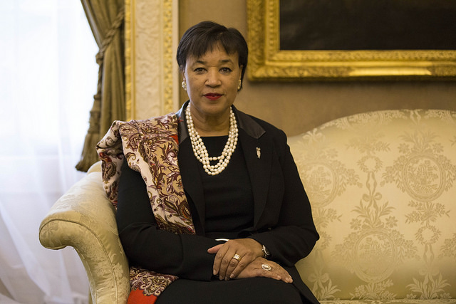 Colour photo of Patricia Scotland sitting on a couch