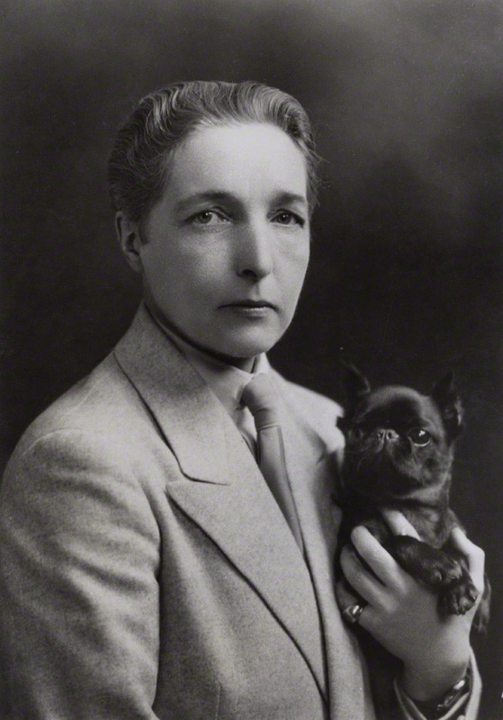 Black and white portrait photo of Radclyffe Hall and her dog