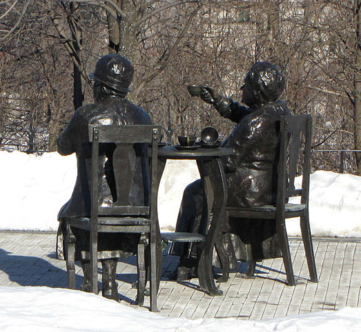 Colour photo of the statute of two women who challenged the women are persons law in Canada
