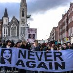 Colour photo of day protest with banners of Savita Halappanavar and Never Again
